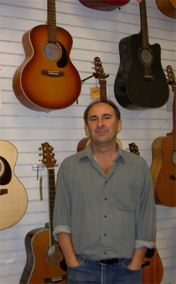 Dave Byron teaches guitar lessons at Jansen Music store in Aptos, CA